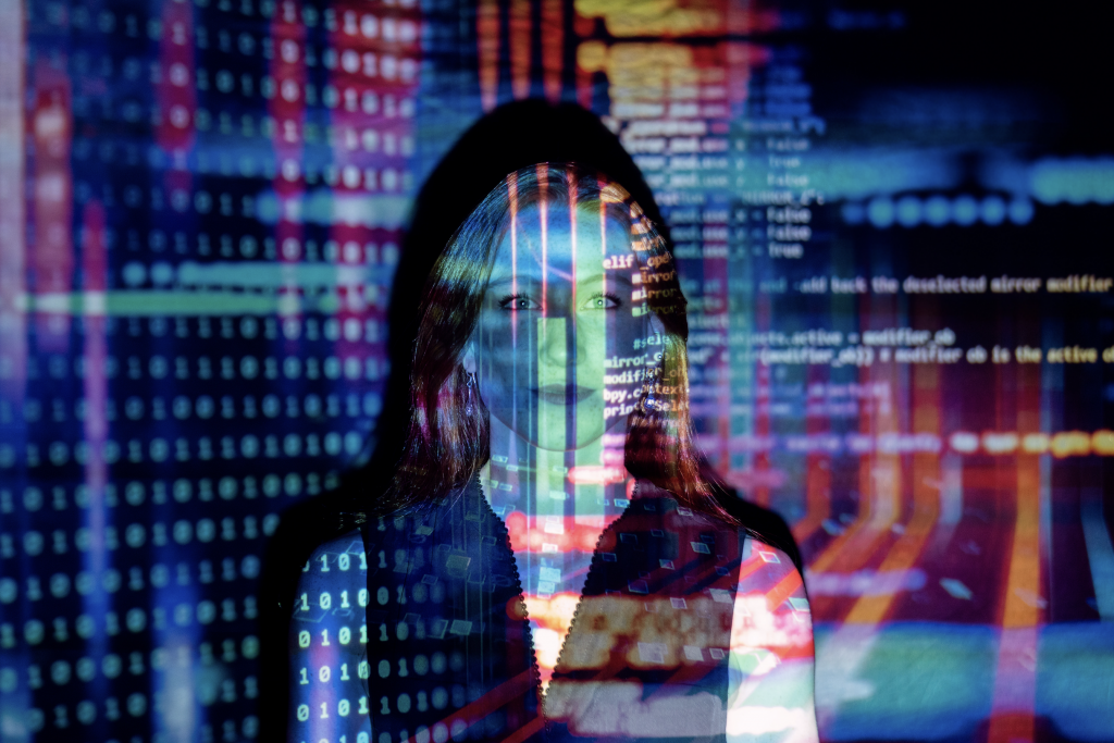 woman-standing-in-front-of-code-on-screen